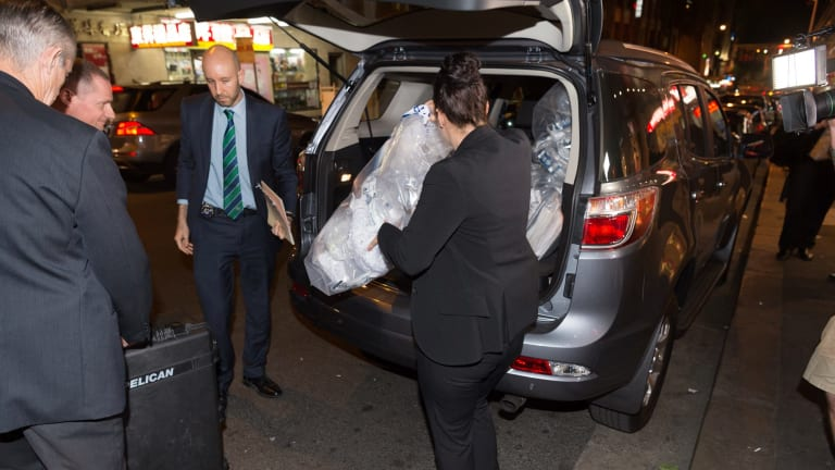 Australian Federal Police remove shredded documents and other evidence during a raid the NSW AWU offices.
