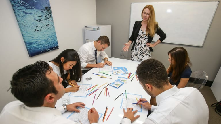 Alicia Nees with staff from Precision Sourcing as they add colour to their working day.