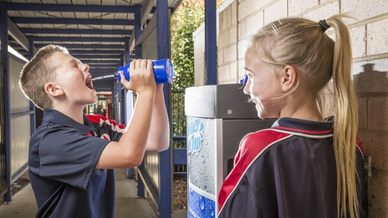 Year 6 students Declan Yates and Kim Shoard, both 11, use the new water resource station at Monash Primary School.