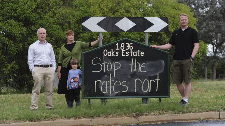 Oaks Estate residents are unhappy with the ACT government over their rates and services. From left, Pablo Serazio, Kate Gauthier, her son Luther Griffin, 4, and Adam Stokes.