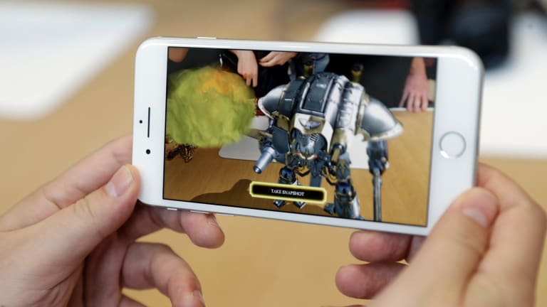 iPhone 8 has better cameras and expanded AR capabilities.