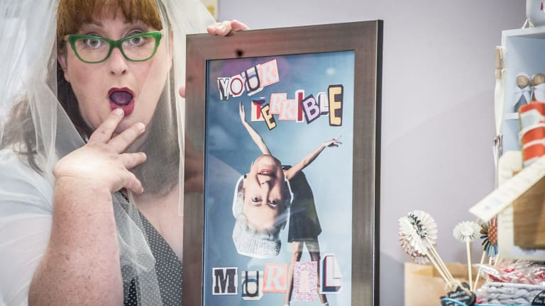 """Canberra's own iconic actress Gabby Millgate (of Muriel's Wedding fame) has created the """"You're Terrible Mural"""" products, puns that will appear on tea-towels and mugs. They will be stocked at The Markets Wanniassa."""