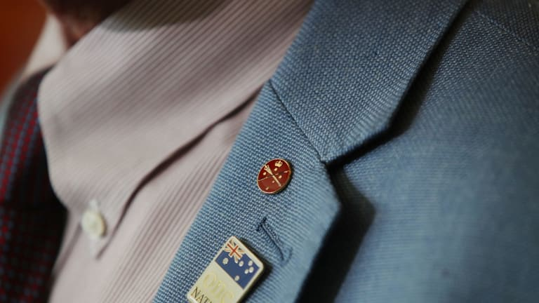 Malcolm Roberts wears a senator's pin to a his press conference on Friday.