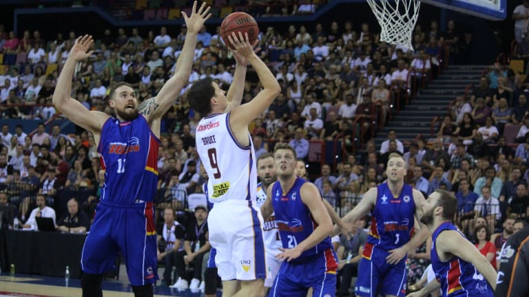 Brisbane guard Shaun Bruce drives to the hoop for two of his 12 points against Adelaide on Thursday night.