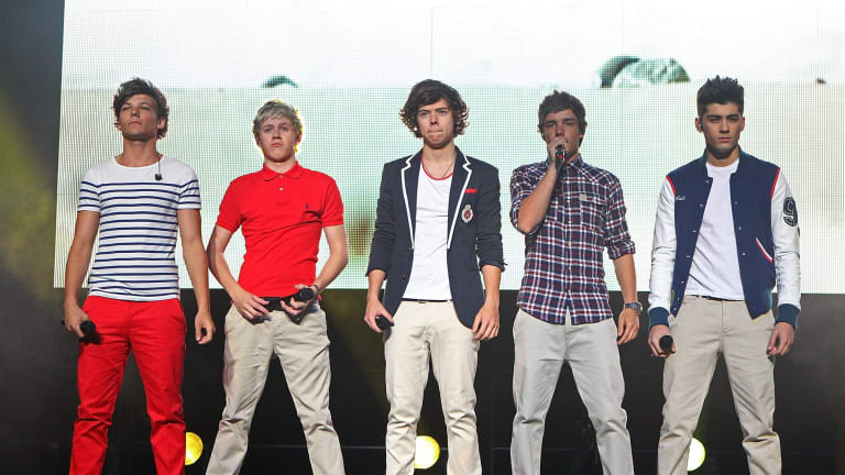 Harry Styles (middle) with One Direction on stage in Australia in 2012.