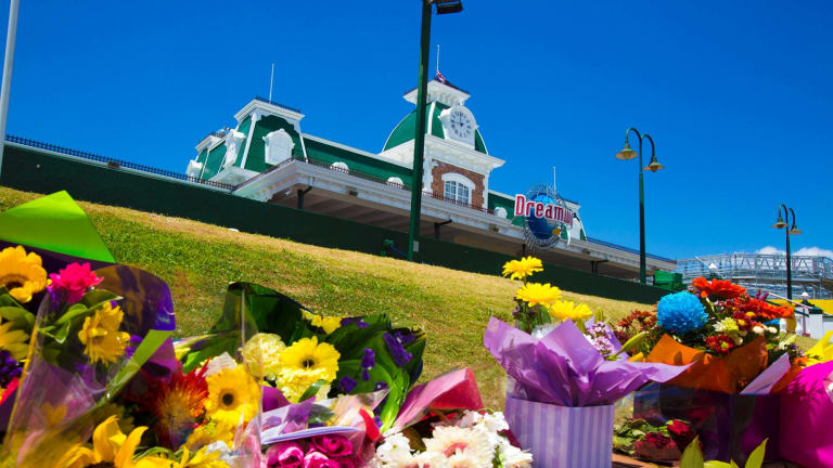 A memorial to the four victims has grown outside Dreamworld.