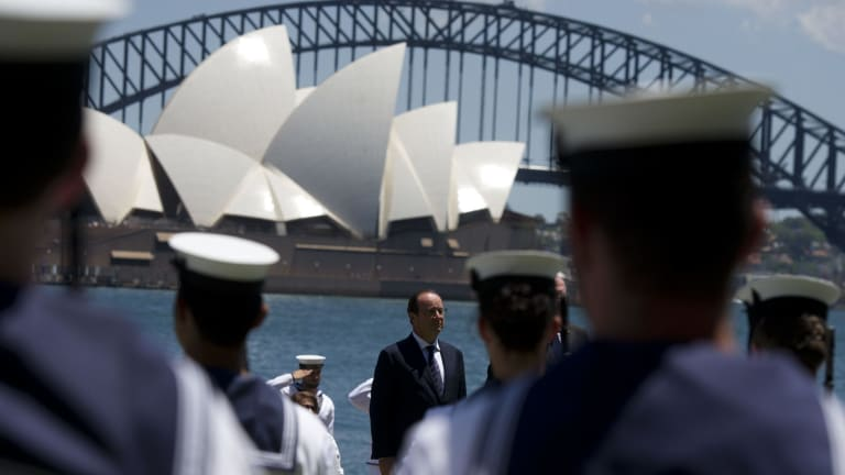 French President Francois Hollande attends a 21-gun salute on the harbour.