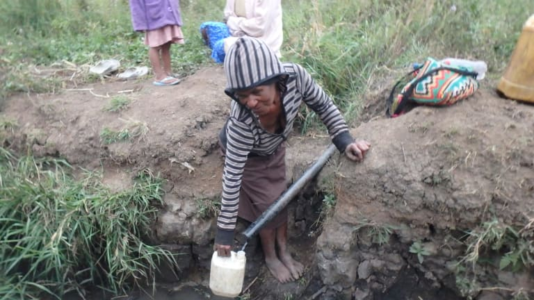 Water shortages force PNG villagers to walk long distances in the Eastern Highlands to collect drinking water.