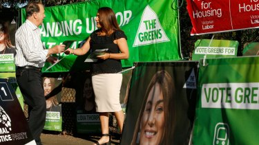 How do you deal with a problem like the Greens? Greens candidate in the Northcote byelection Lidia Thorpe hands out how to vote cards at Thornbury Primary School.