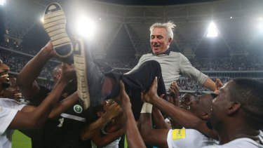 Bert van Marwijk is thrown into the air by the Saudi players after leading them to the World Cup. His contract was not renewed for the tournament.