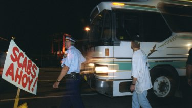 1998: Police escorting non-union labour to Patrick Stevedores through the MUA picket lines.