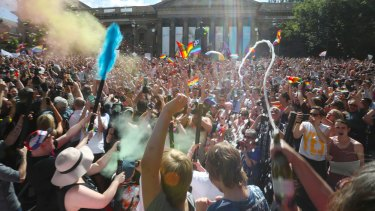 Hundreds celebrate the 'yes' vote to same-sex marriage outside Melbourne's State Library.