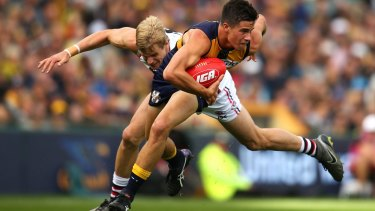 Nick of time: Liam Duggan shrugs a tackle by St Kilda captain Riewoldt.