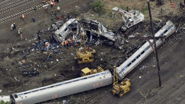 Emergency personnel work at the scene of the deadly Amtrak train derailment.