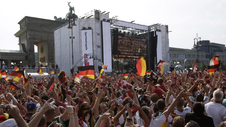 The party continues: German fans celebrate the return of their team in Berlin on Tuesday.