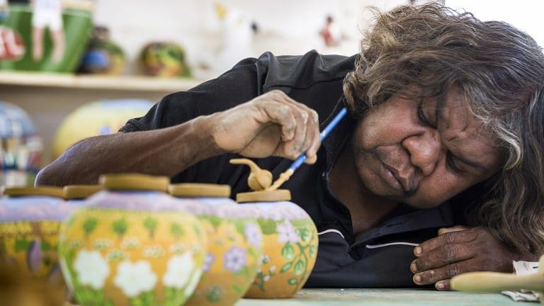 Artist Rona Rubuntja of the Hermannsburg Potters at work in the studio.