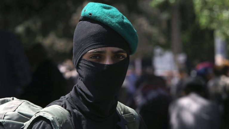 A masked militant from the Izzedine al-Qassam Brigades, a military wing of Hamas, in Gaza.