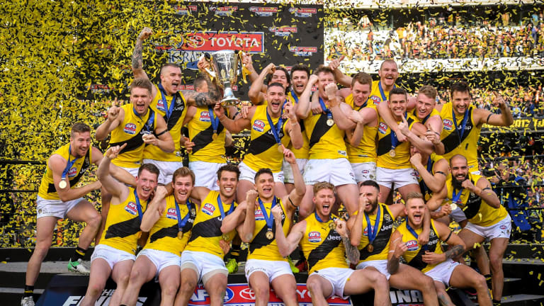 Rance and the Tigers celebrate with the premiership cup.