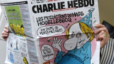 Reading the latest issue of the French satirical newspaper Charlie Hebdo in Paris.