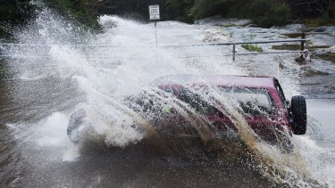 High water at the West Oxford falls crossing as rains increase in Sydney.