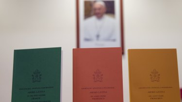 Copies of the post-synodal apostolic exhortation ' Amoris Laetitia ' (The Joy of Love) on display prior to the start of a press conference, at the Vatican on Friday.