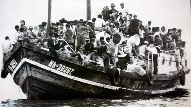 A group of Vietnamese boat people arriving in Australia.
