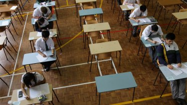 Business Studies and Classical Greek students from Killara High School sit for their first HSC exam.
