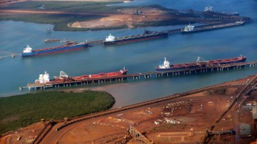 Bulk carriers are loaded with iron ore off Port Hedland.