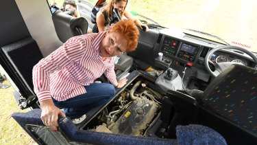 One Nation leader Pauline Hanson inspects the engine bay of the Battler Bus on Thursday.