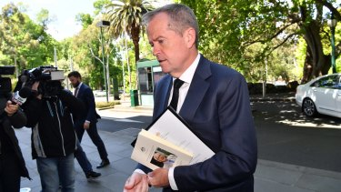 Opposition Leader Bill Shorten arrives for the meeting with Prime Minister Malcolm Turnbull.