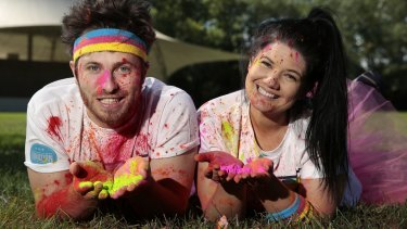 Ryan Jon and Tanya Hennessy threw themselves into Canberra life, including participating in the colour run.