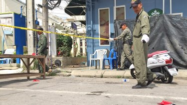 Investigators work at the scene of an explosion in the resort town of Hua Hin on Friday.
