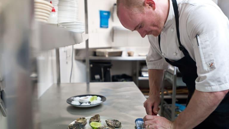 Awe shucks: Temporada chef Chris Darragh prepping the beautiful oysters.