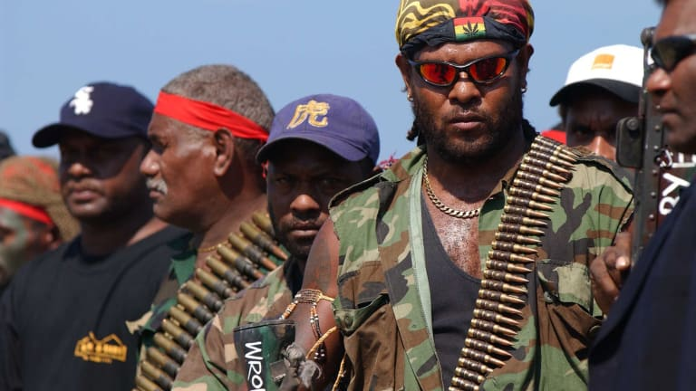 Militia leaders and fighters surrendered weapons and ammunition in 2003 after the international mission restored peace to the islands.