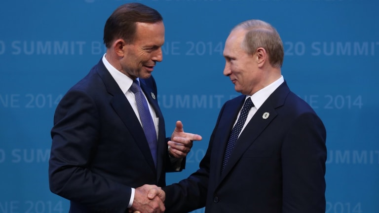 Former Prime Minister Tony Abbott greets Russian President Vladimir Putin at the 2014 G20 Summit in Brisbane.