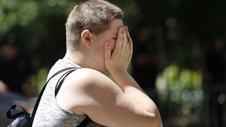 Bob Civil reacts in front of a New York memorial for victims of the Orlando nightclub shooting.