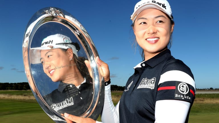 Reflected glory: Minjee Lee with the women's Vic Open trophy at 13th Beach Golf Links in Barwon Heads.