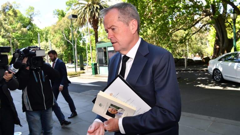 Opposition Leader Bill Shorten arrives for the meeting with Prime Minister Malcolm Turnbull.