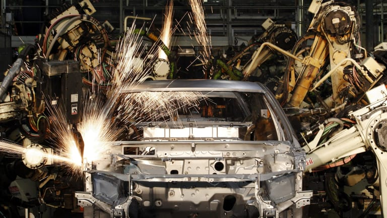 Robots put together a car at a Toyota factory in Australia.