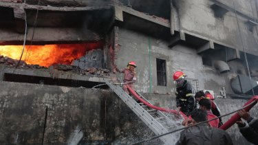 Firefighters work to put out the fire at a packaging factory in Tongi industy area outside Dhaka, Bangladesh.