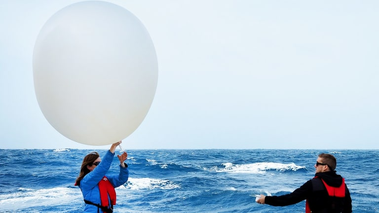 No thought bubble: Deploying weather balloons from RV Investigator.