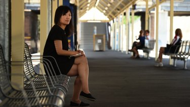 Vivian Feng (left) from West Ryde waits for the train at Chester Hill station.