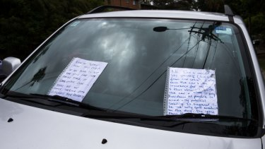 An exchange of notes left on a car parked on the side of the road in a completely legal spot indicates the rising level of frustration in the search for on-street parking.