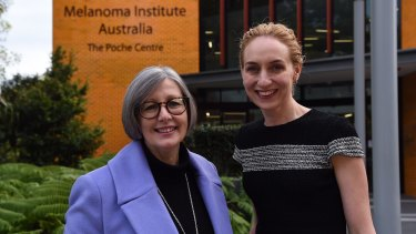 Professor Georgina Long, right, with clinical trial participant Renae Aslanis outside the Melanoma Institute Australia's offices in Sydney.
