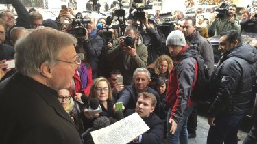Cardinal George Pell makes a statement following a meeting with survivors of sex abuse.