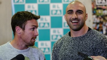 Pay up: Tim Mannah and James Maloney speak at the The Rugby League Players Association (RLPA) mass player meeting.