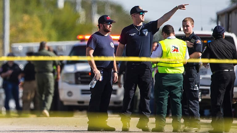 Law enforcement officials at the scene of a fatal shooting at the First Baptist Church in Sutherland Springs, Texas, on Sunday.