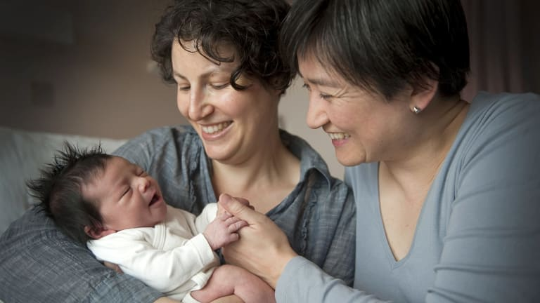 Penny Wong and partner Sophie Allouache and their daughter Alexandra in 2011. Their second daughter, Hannah, was born earlier this year.