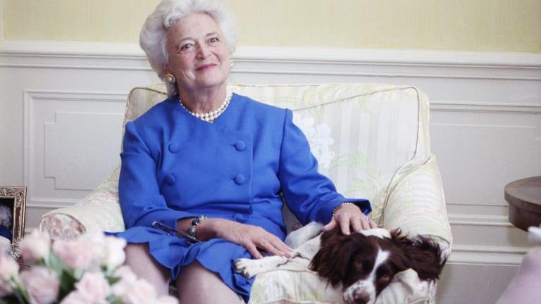 Barbara Bush poses with her dog Millie in Washington, 1990.