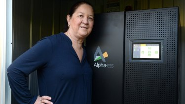 """Jane Whiltsher poses with her """"new toy"""" - the battery that powers her home."""